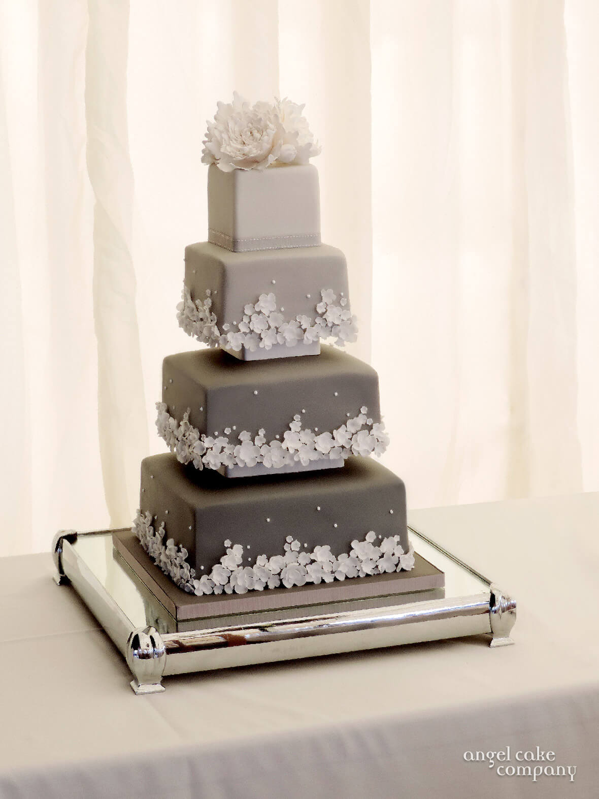 Four Tier Wedding Cake Decorated With Graduating Shades Of Grey Icing And White Flowers Not Your Everyday Choice Colours For A