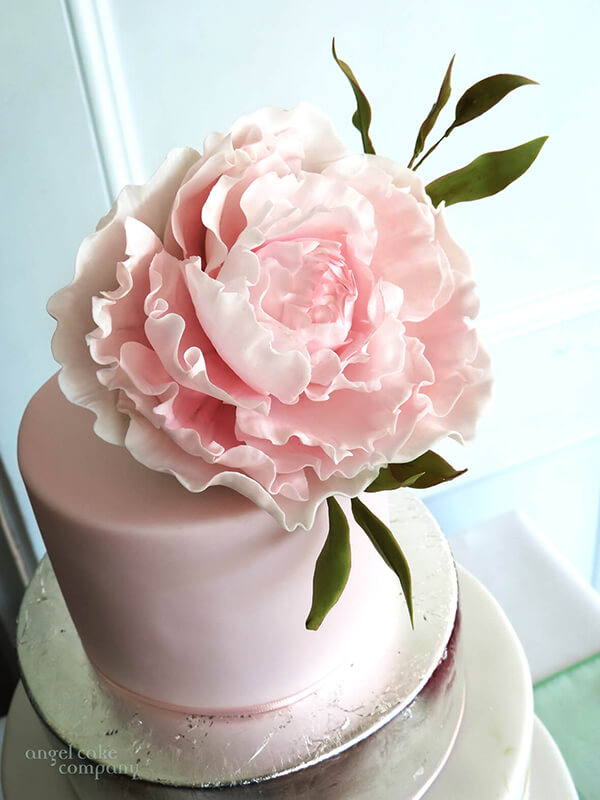 A beautifully hand crafted sugar peony cake topper